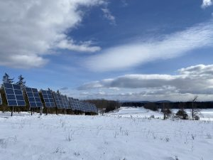 solar array in snow covered pasture